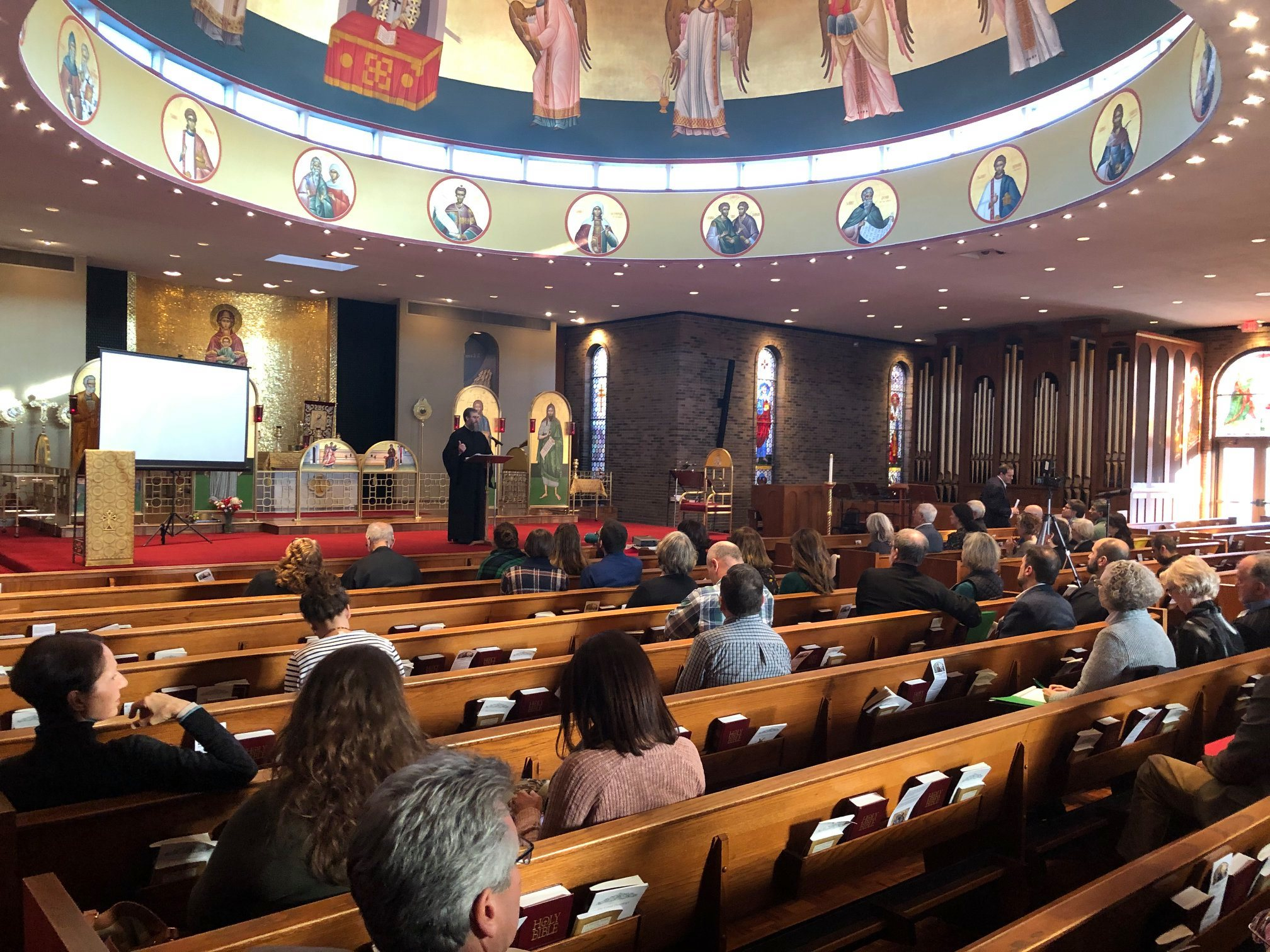 Plenary speech in crowded cathedral